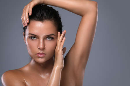 Potrait of young beautiful woman with oily and wet skin Stockfoto