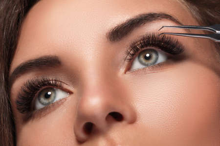 Beautiful woman with eyelash extension for maximum volume