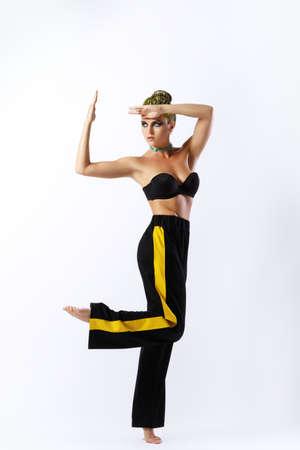 Stylish woman with yellow hair in pants with stripe 版權商用圖片 - 106030827
