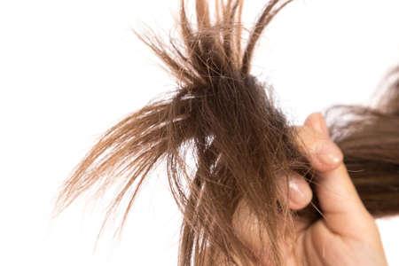 Cheveux féminins sur fond blanc Banque d'images