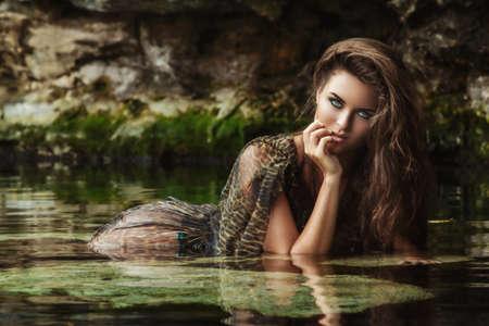 Portrait of woman wearing  wild dress in the water