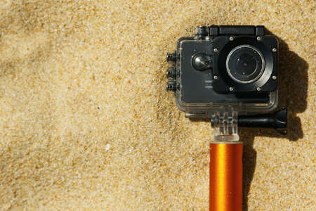 Action camera in waterproof case on the beach 写真素材