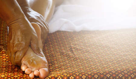 Close up of female feet during traditional Thai massage