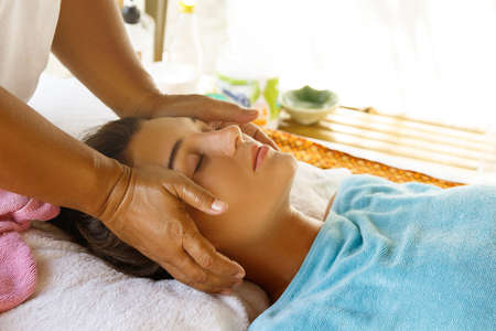 Woman during professional head massage