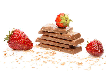 Strawberries and chocolate bar on white background Archivio Fotografico