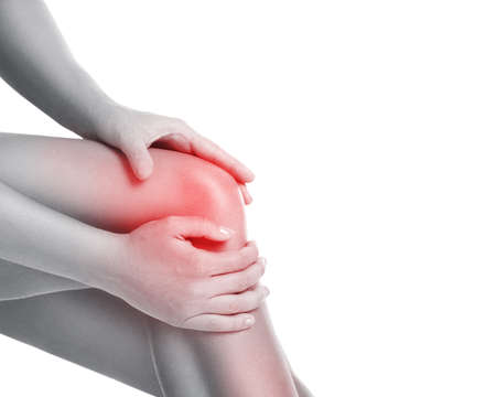 Woman with pain in her knee on white background