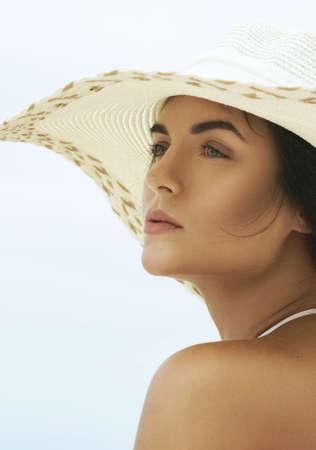 Portrait of beautiful woman in beach hat