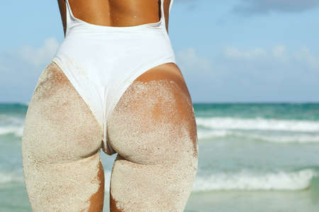 Woman with sexy buttocks on the beach