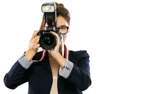 Woman photographer with a DSLR camera isolated on white background Stockfoto