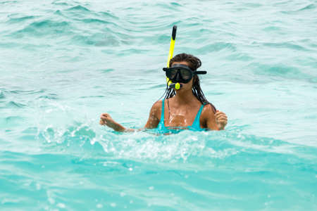 Woman swimming in the sea with a snorkeling mask