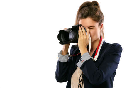 Woman photographer with a DSLR camera isolated on white background Foto de archivo
