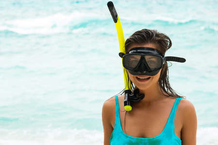Young woman  with a mask for snorkeling. Summer and beach holidays.