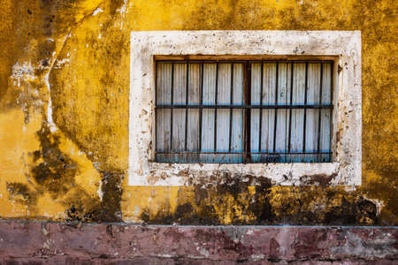 Old window and colorful grungy house