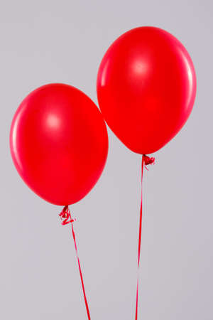 Two colorful balloons isolated on gray background