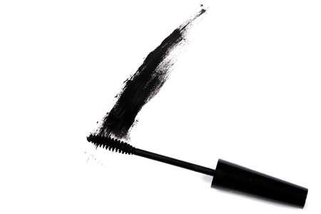 Smudged mascara on white background