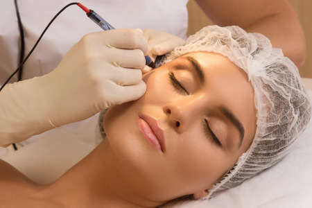 Beautiful woman in cosmetology salon during rejuvenation treatment Stock Photo