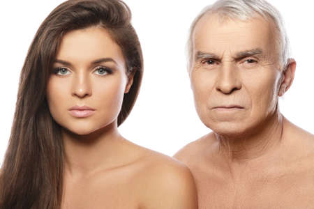 Elderly and very strict father and his beautiful daughter on white background