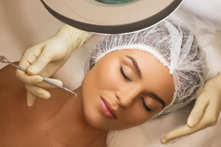 Woman in the professional beauty salon during a mechanical face cleansing procedure