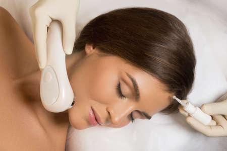 Beautiful woman in professional beauty salon during face polishing treatment