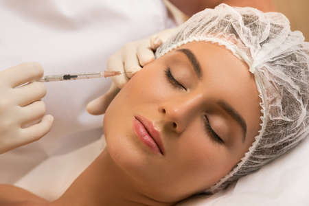 Woman in professional beauty salon during facial injections for rejuvenation Banque d'images