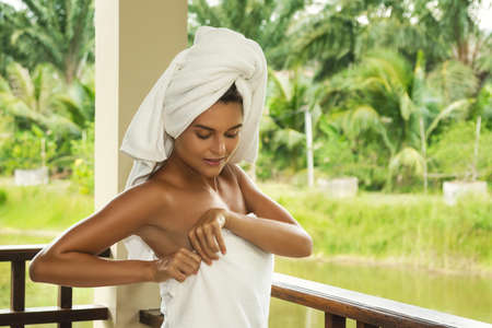 Vacations in tropical warm country. Happy and beautiful woman on the balcony after shower. Фото со стока - 133672815