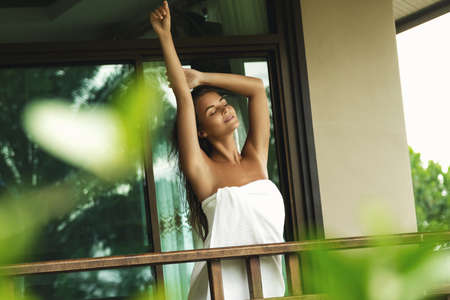 Vacations in tropical warm country. Beautiful woman on the balcony after shower. Фото со стока - 133671279