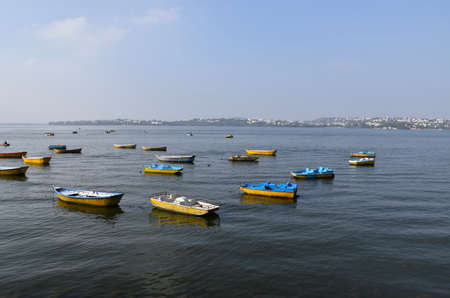 Small multi-color boats sailing in the lake, Bhopal