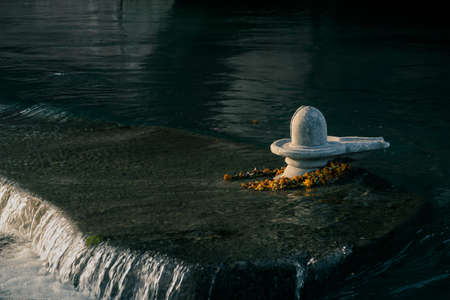 Hindu religious shivling in the middle of river Ganga