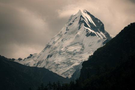 Landscape shot of Gangotri Glacier under dark overcast sky