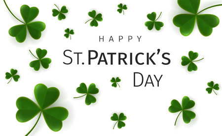 St. Patricks Day greetings card with flying clover leaves on a white background. Irish traditional holiday