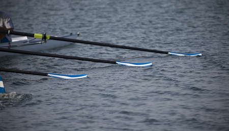 oar: Oars lie on water. Stock Photo