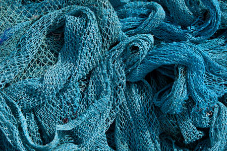 fishing industry: Blue Heap of Commercial Fishing Net. Stock Photo