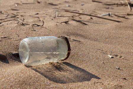 Pollution - Jar on Beach photo