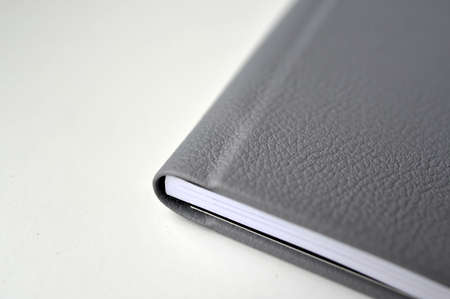 A black leather cover book