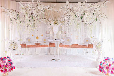 A twin marriage dais for two wedding couples