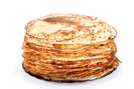 Pile of pancakes on a plate on a white background