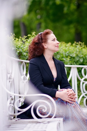 The beautiful business woman on a white bench photo