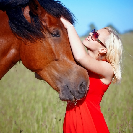 Portrait of the girl embracing a horse photo