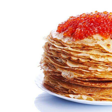 Pancakes with red caviar. Pile of pancakes. Pancakes on a plate. Red caviar.