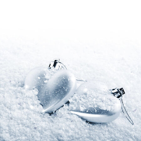 Two hearts on snow. Christmas-tree decorations in the form of hearts. Valentines Day. February 14. Winter holiday. Stock Photo