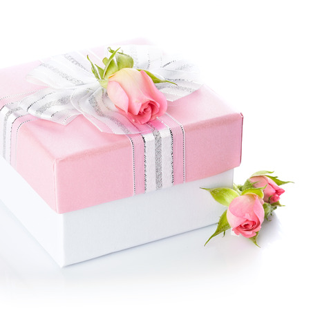 Gift box and roses. Festive surprise.  photo