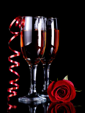 Rose with glasses and a red tape Alcohol and flower. Glasses with drink and a red rose. photo