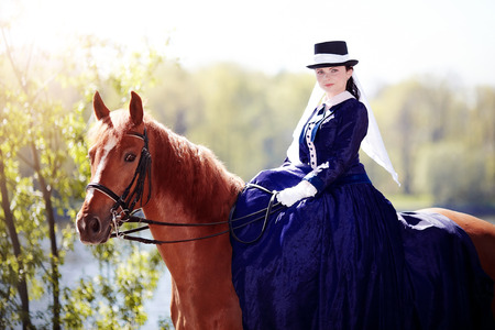 Lady on a  horse.