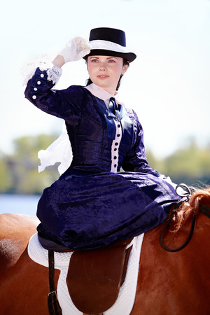 Lady on a  horse.  photo