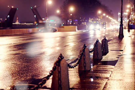 The wet street at night in St. Petersburg. photo
