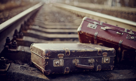 Two old fashioned suitcases on the railway. Standard-Bild