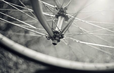rapidity: Not the color image of a forward  wheel of the bicycle with bokeh