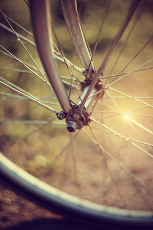 rapidity: Forward wheel of the bicycle close up with bokeh