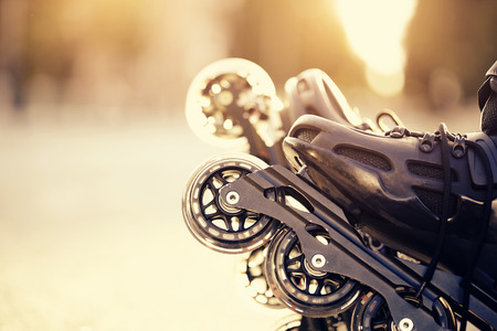 inline skater: Wheels of roller skates closeup in the rays of the sun.