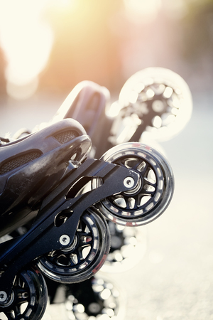 The wheels of roller skates closeup in the rays of the sun.